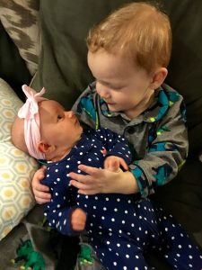 Brother with new baby sister